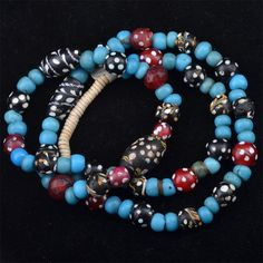"""Lewis and Clark, French Ambassador, red and black skunk and blue Venetian beads. From the early (The name """" Lewis and Clark"""" beads is deceptive, because they werd not traded with the indians in the famous L & C expedition). African Bracelets, Beaded Moccasins, Fur Trade, Beaded Necklace, Beaded Bracelets, Lewis And Clark, African Trade Beads, Native American Beadwork, Recycled Jewelry"""