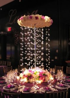 We see the illusion of floating bubbles again in this Pintrest photo, but here the element is incorporated into an extra tall centerpiece perfect for the Main Dining Room's high ceilings.