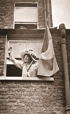 Christabel Pankhurst waving to the hunger strikers from a house overlooking Holloway Prison, 1909