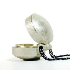 Relic silver hinged container locket | Contemporary Necklaces / Pendants by contemporary jewellery designer Sophie Stamp