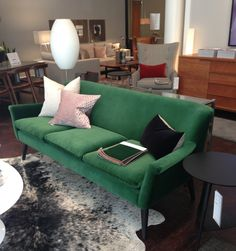 Emerald green couch at Room and Board
