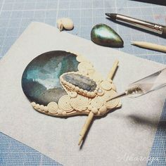 ⭐My inspiration is coming back! ⭐ Work in Progress - Galaxy Pendant - a disc of wood hand painted with working in clay.  The paint and the clay color has to be over yet. Listening to one of my favorite albums:  #okumuki by L'Aura #elleapostrofoaura !   #handmade #claypendant #workinprogress #handpainted #woodpainting #kyanite #galaxyart #galaxypendant #crystalcreations #healingjewelry #healingstone #newage #awakening #paganart #boho #instaart #wip #instajewelry #galaxyjewels
