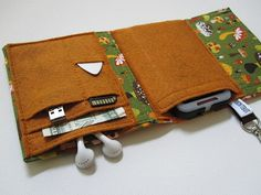 Hey, I found this really awesome Etsy listing at http://www.etsy.com/listing/76830499/nerd-herder-gadget-wallet-in-shroom-for
