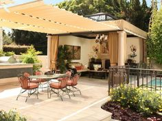 A vertical hanging pocket garden surrounds a pergola-shaded outdoor dining area in this backyard. A variety of hanging glass pendant lamps are sophisticated additions to the rustic, weathered-wood terrace. Outdoor Living Areas, Outdoor Rooms, Outdoor Dining, Dining Area, Outdoor Kitchens, Kitchen Dining, Outdoor Patios, Dining Rooms, Living Spaces