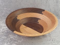 Segmented Wooden Bowl made using a unique Dovetail application, it is 10.5 X 3 in size. The unique designs of this bowl makes it perfect to