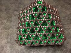 This is an Octahedron with a hexagonal lattice second layer. Made from Glow in the Dark Neocube magnets, and silver Zen Magnets #ZenMagnets #Neocube #Gustoph