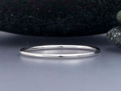 Thin Platinum Wedding Band 1mm Round Stacking by LichenAndLychee $225 I like how thin and delicate it is.