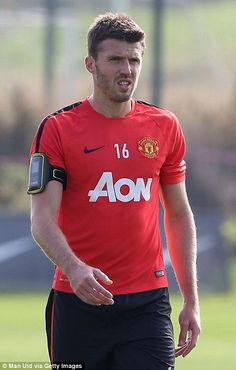 On the mend: Michael Carrick has returned to training after injury...