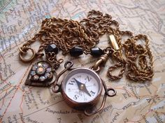 I think I need a retro compass necklace in my life.
