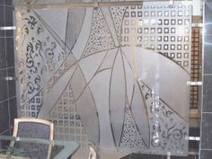 Sandblasting : geometric patterns. Note the various degrees of opacity