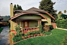 A new color scheme of earthy greens and browns brought an Arts & Crafts aesthetic to the exterior.