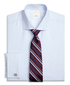 Our dress shirt is crafted from pure Egyptian cotton twill, woven in Italy, for unmatched comfort. The English spread collar provides an ideal frame for more substantial tie knots. Our signature 6-Pleat Shirring® at the French cuffs reinforces Brooks Brothers dedication to a well-made dress shirt. Additional features include a French front placket and a chevron split-back yoke. This shirt is machine washable for easy care. Made in the USA of imported fabric. Cuff links not included…