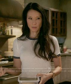 Joan's white tee with black trim on Elementary.  Outfit Details: https://wornontv.net/62412/ #Elementary