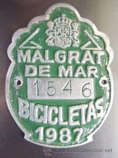 matricula de bicicleta malgrat de mar 1987 nº1564 con el escudo de españa