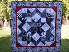 Black, White and Red All Around ~ 54 x 54. Designed by Kathie Holland. I made this quilt from charms swapped with members of AAQMB in 2003. Top made, quilted and finished in 2011. #Carpenter'sStar
