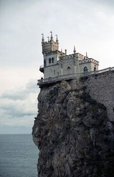 Green Renaissance  Built between 1911 and 1912, the Swallow's Nest is a decorative castle near Yalta on the Crimean peninsula in southern Ukraine. The castle stands on top of 40-metre (130ft) high Aurora Cliff, to a Neo-Gothic design by the Russian architect Leonid Sherwood and overlooks the Cape of Ai-Todor of the Black Sea.