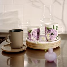 In spring Marimekko's new Oiva tableware and flowerpots are adorned with terra, a cool tone of brown, and Primavera, Maija Isola's classic print from the in lilac. Goods And Service Tax, Goods And Services, Marimekko Fabric, Cool Tones, Rustic Feel, Flower Pots, Fabric Design, Kitchen Dining, Stoneware
