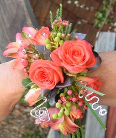 coral corsage with deco wire~Stems Flower Shop