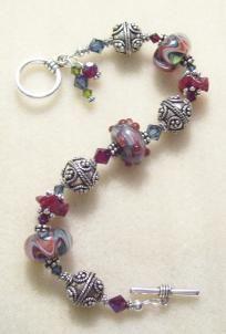 Burgundy Red Blue Green Handmade Boro Glass Swarovski Bead Bracelet $62.00  Would be so easy to make for lots less.