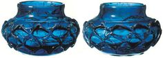 Two squat blue jars/beakers decorated with an applied floral design (seven petals) on the base and plaitwork with three overlapping wavy lines around the body. From the 7th century Anglo Saxon grave site of the 'Prittlewell Prince' in Essex excavated in 2003