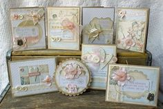 Several cards in pastel tones with hearts buttons, ribbons and stars