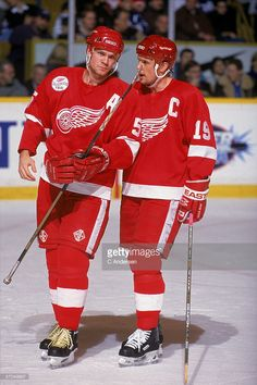 Canadian hockey player Steve Yzerman (right) of the Detroit Red Wings talks with Swedish teammate Nicklas Lidstrom on the ice during a road game, Toronto, Ontario, Canada, December Michigan Hockey, Detroit Hockey, Detroit Sports, Pittsburgh Penguins Hockey, Detroit Tigers, Canadian Hockey Players, Nhl Players, Hockey Girls, Hockey Mom