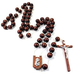 Wall #rosary with #wooden #beads and metal links, oxidized #Madonna and Child over wood center and a wooden #crucifix with a metal corpus. The wall rosary makes a great addition to your home, gift for wedding, or for someone you care. Made in #Italy. Product number (sku): 9-12001