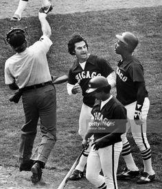 Umpire Josh Sherlock, left, knocks off Chicago White Sox manager Tony LaRussa's…