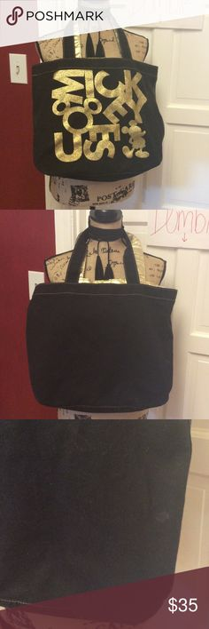 Walt Disney world black & gold Mickey Tote So cute bought in magic kingdom a few years ago - has a few spots on the back - will probably come out with a washing this is machine washable Disney Bags Totes