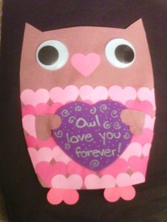 I came up with this idea after seeing some of the cute valentines out there this year.  It's just construction paper and googly eyes.  The trick is to get a heart punch to save you from cutting out all those hearts.