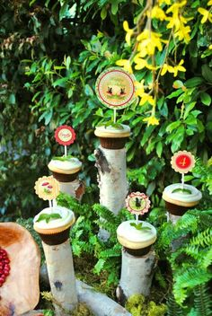 Love this party decor, i did this cupcake stand display for a bridal party around a log cake that a friend did.