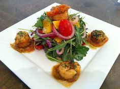 5 Doors Down - Monday Night Dinner Feature  Pan Seared Scallops served on a Arugula Salad with Orange Segments and Cherry Tomatoes tossed in a Lemon Grass Vinaigrette topped with a Golden Plum Relish $23 Golden Plum, Pan Seared Scallops, Orange Salad, Arugula Salad, Monday Night, Lemon Grass, Tossed, Cherry Tomatoes, Vinaigrette