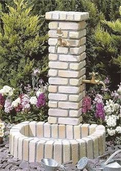 Multiple faucets on brick tower - try full circle and 4 faucets? Garden Deco, Garden Yard Ideas, Backyard Projects, Garden Crafts, Garden Projects, Garden Tools, Garden Hose Storage, Garden Sink, Garden Fountains