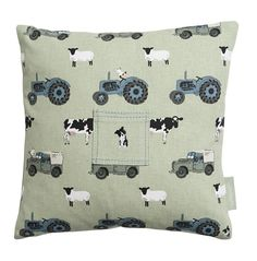 Tooth Fairy Cushion - 'On The Farm'. A gorgeous little Tooth Fairy Cushion in our popular green 'On the Farm' fabric. Tractors, Land Rovers, cows, sheep and chickens cover the cotton fabric. Perfect for little farmyard fans to hide their lost tooth in so that tiny fairies can find them easily in the middle of the night!
