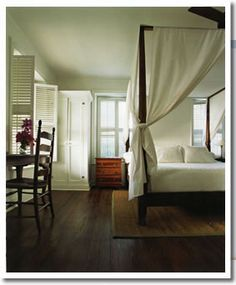 mahogany furniture, white linens...the perfect colonial caribbean look. i love this.