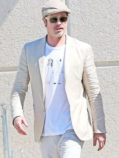 Star Tracks: Monday, July 21, 2014 | SHIRT TALES | Proud papa Brad Pitt wears a familiar tee while arriving at the Marseille Airport in France on Thursday.