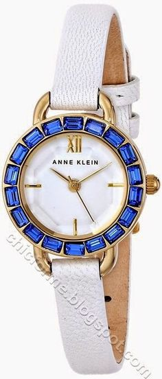 Anne Klein Women's AK/1676BLWT Blue Swarovski Crystal Accented Thin White Leather Strap Watch- buy it here !