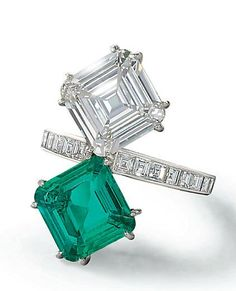 Cartier ring in platinum with matching step cut ~4ct diamond and ~4ct emerald set diagonally on an diamond eternity band
