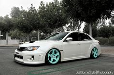 White Subie on colored wheels