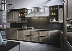 Snaidero FRAME kitchen cabinet has a classic framed door where the recessed handles exude a modern air, a sharp clean silhouette and a timeless appeal. #SnaideroUSA |  Iosa Ghini Design
