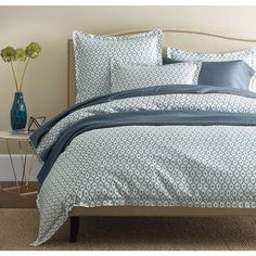 These blue sheets & bedding set are a modern take on traditional Moorish screens. Translated for the bed in sublimely silky, 400-thread count cotton sateen.