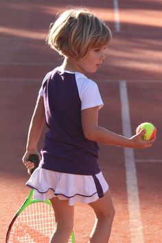 Shop designer children's tennis clothes, ruffle pleated skirt with matching purple and white Raglan sleeve T shirt top designed and made in UK by Zoe Alexander.