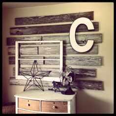 Wood wall made with recycled fence posts #cecelively #diy