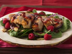 Grilled Chicken and Raspberry-Spinach Salad  ~  An organic raspberry-spread vinaigrette glazes grilled chicken and dresses the spinach-and-raspberries base of a delightful main-dish salad.