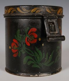 TOLE DECORATED LIDDED CANNISTER. Polychrome decoration in florals, hinged lid and latch, painted sides, top and rim.