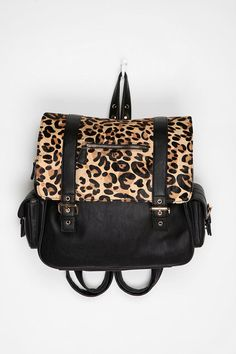 BDG Double Buckle Backpack    I am a complete sucker for Leopard print. I mean, you've seen my adorable coach purse- right?