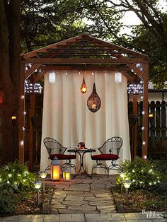 What a difference a little lighting can make! This gazebo glows with illumination from several sources: strings of bulbs, candle chandeliers, solar-powered landscape lights, battery-operated lanterns, and overhead fixtures. Not only do these lights guide Cement Planters, Small Pergola, Small Patio, Rustic Pergola, Cheap Pergola, Outdoor Rooms, Outdoor Living, Outdoor Decor, Decks