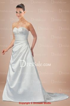 Delicate Design of White Bridal Gown Features Fashionable Scalloped Bodice and Wonderful Beadwork