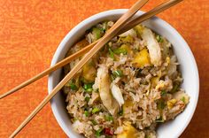Crab Fried Rice with Pineapple.       3 T peanut oil, lard or other vegetable oil, divided      2 to 3 eggs, lightly beaten      3 to 4 green onions, chopped      1 T minced fresh ginger      1 T minced lemongrass (optional)      1 t ground Sichuan peppercorns (optional)      3 to 5 dried hot chiles, broken up and partially seeded      1/2 lb crabmeat      1/2 lb pineapple, cut into chunks      3 c cooked, cooled rice      2 to 3 tablespoons fish sauce (or soy sauce)      1/3 c chopped…