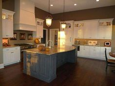 What a cool new trend, of mixing the cabinet colors.  Great idea to add a little character to your kitchen!